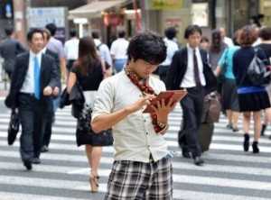 University student Akihiro Matsumura uses his tablet computer in Tokyo on June 19, 2013. Computers and smartphones have relieved youngsters like Matsumura of the need to remember how to write the thousands of Chinese characters or kanji in use across East Asia.