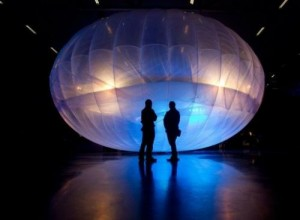 Visitors stand next to a high altitude WiFi internet hub, a Google Project Loon balloon, on display at the Airforce Museum in Christchurch, on June 16, 2013. Google last week revealed top secret plans to launch thousands of such balloons to provide Internet connections to remote parts of the world, allowing the more than four billion people with no access to get online.