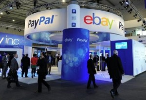 Visitors walk past an Ebay and PayPal stand at the Mobile World Congress in Barcelona on February 27, 2013. PayPal has launched a quest for an intergalactic currency, saying it is time to figure out what space travelers will use as cash.