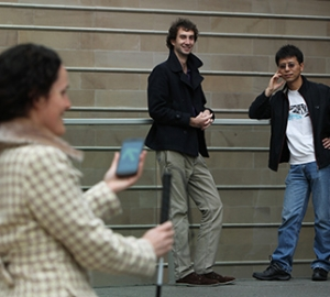 Megan Taylor trialling the app, watched by developers Thomas Gallagher and Binghao Li . Photo: Britta Campion