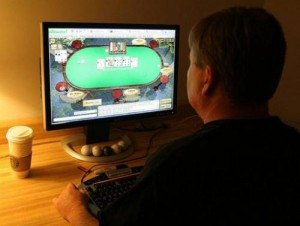 A man plays poker on an Internet gaming site from his home in Manassas, Virginia on October 2, 2006. At least two bills to regulate Internet gambling have been introduced in the House of Representatives, and a Senate committee has scheduled a hearing on Wednesday on the matter.