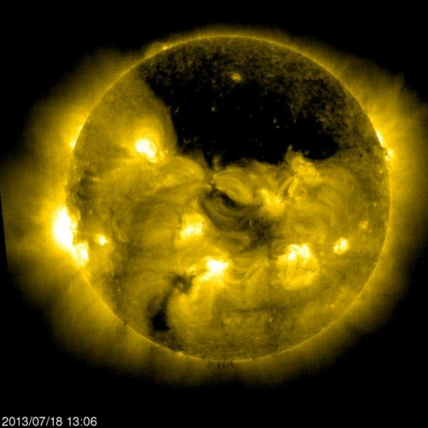 The European Space Agency/NASA Solar and Heliospheric Observatory, or SOHO, captured this image of a gigantic coronal hole hovering over the sun's north pole on July 18, 2013, at 9:06 a.m. EDT. Image Credit: ESA&NASA/SOHO