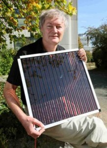This is Michael Grätzel holding one of his dye-sensitized solar cells Credit: EPFL