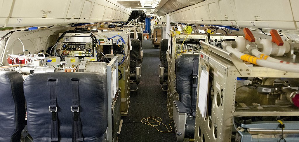 NASA's DC-8 flying laboratory is fully loaded with seats and instrument racks in preparation for NASA's 2013 SEAC4RS climate science mission. Image Credit: NASA / Tom Tschida