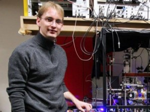 Physicist Jerome Lodewyck is pictured next to an atomic optic clock on March 19, 2009 in Paris. Physicists said Tuesday that a so-called optical lattice clock, touted by some as the time-measuring device of the future, had passed a key accuracy test.