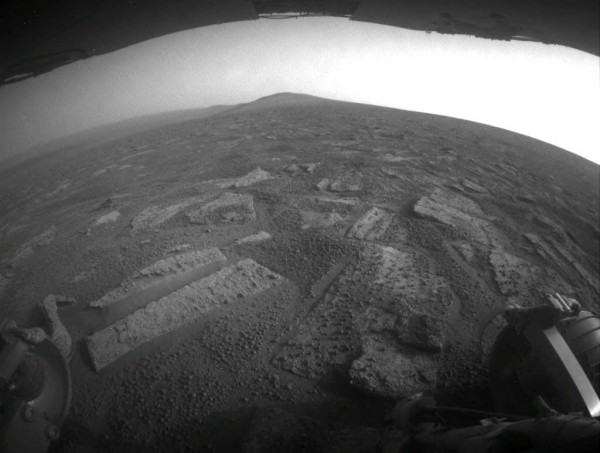 "This view shows the terrain that NASA's Mars Exploration Rover Opportunity is crossing in a flat area called ""Botany Bay"" on the way toward ""Solander Point,"" which is visible on the horizon. Image Credit: NASA/JPL-Caltech"