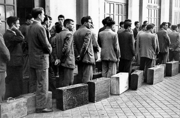 Spanish emigrants wait to leave the country in the 1960s, a pattern that is being repeated today as Spanish youth swap laptops for cardboard cases and leave in droves to find a better life. Source: Supplied