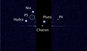 This image, taken by the NASA/ESA Hubble Space Telescope, shows five moons orbiting Pluto, the distant, icy dwarf planet, on July 7, 2012. Pluto's fourth and fifth moons, discovered in 2011 and 2012, have been named Kerberos and Styx, the International Astronomical Union (IAU) said on Tuesday.