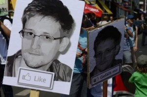 """Demonstrators take part in a protest against the US National Security Agency (NSA) collecting German emails, online chats and phone calls and sharing some of it with the country's intelligence services in Berlin on July 27, 2013. A secret surveillance system known as XKeyscore allows US intelligence to monitor """"nearly everything a typical user does on the Internet,"""" according to leaked documents."""