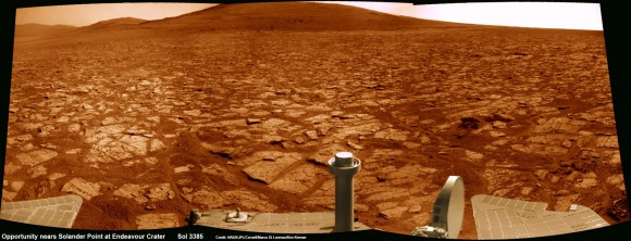 Opportunity rover's 1st mountain climbing goal is dead ahead in this up close view of Solander Point at Endeavour Crater. Opportunity will ascend the mountain looking for clues indicative of a Martian habitable environment. This navcam panoramic mosaic was assembled from raw images taken on Sol 3385 (Aug 2, 2013). Credit: NASA/JPL/Cornell/Marco Di Lorenzo/Ken Kremer