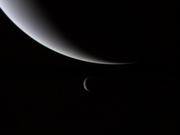 Neptune and its large moon Triton as seen by Voyager 2 on August 28th, 1989. (Credit: NASA).