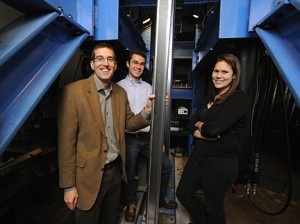Prior to earthquake trials in Buffalo, Prof. Ben Schafer, left, and his students tested cold-formed steel in his lab at Johns Hopkins. With him are doctoral student Kara Peterman, right, who is overseeing testing in Buffalo, and Luiz Vieira, who participated in the research while earning his doctorate. Photo: Will Kirk/Homewoodphoto.jhu.edu