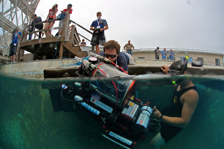 Team leader Markus Burkardt '14 helps a volunteer Navy diver get Ragnarök out of the water at the 16th RoboSub competition.
