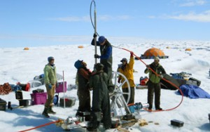 Drilling boreholes on the ice sheet.