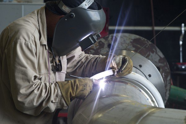 A welder at NASA's Stennis Space Center works on a portion of piping to be installed on the A-1 Test Stand for RS-25 rocket engine testing. Image Credit: NASA/SSC