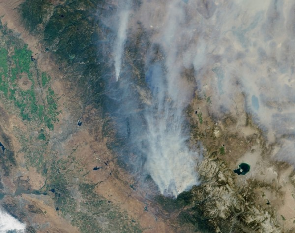 Visible image of California's Rim Fire acquired Aug. 23, 2013 by the Multi-angle Imaging SpectroRadiometer (MISR) instrument on NASA's Terra spacecraft, showing extensive, brownish smoke. The imaged area measures 236 by 215 miles (380 by 346 kilometers). Image Credit: NASA/GSFC/LaRC/JPL, MISR Team