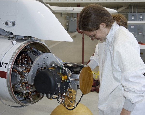 JPL engineer Hannah Goldberg checks out the MSL Curiosity landing radar in the Quick Test Experimental Pod on NASA Dryden's F/A-18 aircraft prior to flight tests in 2011. (NASA / Carla Thomas)