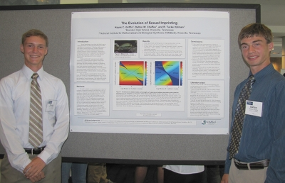 Hayes Griffin (left) and Dalton Chaffee (right) present their award-winning research at the international meeting of the Society for Mathematical Biology in 2012. Photo credit: NIMBioS