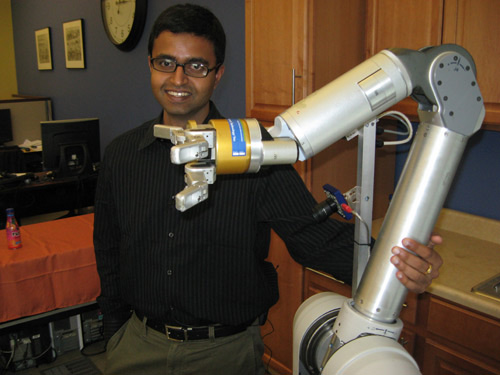 Researchers at Intel Labs located on the campus of Carnegie Mellon University in Pittsburgh are working on a way to take the drudgery out of house work. They are designing a robot named HERB (for Home Exploring Robotic Butler) to be smart and resourceful. Their idea is to create a robot that can walk into a home, assess the layout and move about on its own. Researchers believe senior citizens and the disabled will be the early adopters of robot butlers, since they most need help around the house. Still in the early stages of development, HERB rolls around on a Segway®, the well-known stand-and-ride scooter. The robot has one long arm with three fingers, made by Barrett Technologies, to pick up objects. Barrett is funded by NSF's Small Business Innovation Research (SBIR) program. HERB also has a camera to see and a spinning laser that maps out a 3-D model of where it is at any given time. Two on-board computers process the information and create a cartoon of HERB's environment. That 3-D cartoon is what HERB uses for navigation. Credit: Science Nation, National Science Foundation