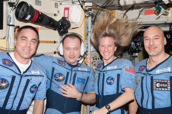NASA astronaut Chris Cassidy (left), Russian cosmonaut Alexander Misurkin, NASA astronaut Karen Nyberg and European Space Agency astronaut Luca Parmitano (right), all Expedition 36 flight engineers, pose for a portrait in the Zvezda Service Module of the International Space Station. Image Credit: NASA