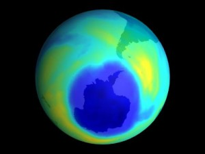 "A map of ozone concentrations in the Southern Hemisphere shows thinning of the ozone layer over the South Pole. This region of reduced ozone, which is called the ""ozone hole,"" causes changes in wind patterns and cloud cover. Credit: NASA"