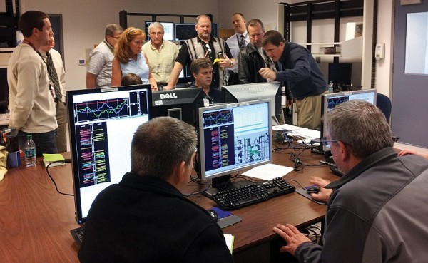 In early 2012 at the North Texas Research Station lab, NASA and FAA traffic management coordinators review the PDRC system before a full operational evaluation to follow a few months later. Image Credit: NASA