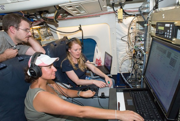 Researchers monitor instruments on the DC-8 during the SEAC4RS Aug. 12 flight. Image Credit: NASA / Lauren Harnett