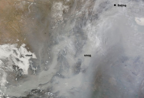 Dense smog, comprised of various pollutants, settled over the North China Plain on Feb. 20, 2011. Scientists have calculated the relationship between pollution and urban population. Image Credit: NASA Goddard's MODIS Rapid Response Team