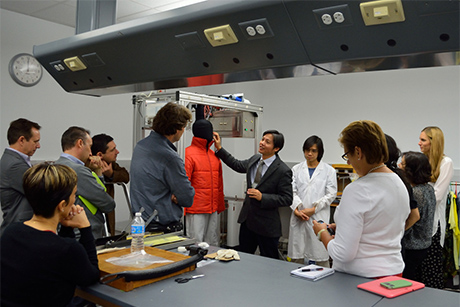 Jintu Fan, chair of the Department of Fiber Science & Apparel Design, talks about the department's sweating mannequin, Walter, which was developed by Fan and is used to test performance apparel. Credit: Mark Vorreuter.
