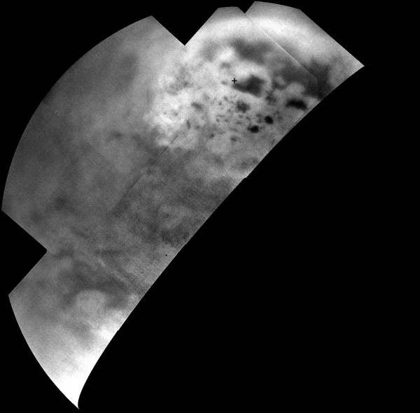 Ultracold hydrocarbon lakes and seas (dark shapes) near the north pole of Saturn's moon Titan can be seen embedded in some kind of bright surface material in this infrared mosaic from NASA's Cassini mission. Image Credit: NASA/JPL-Caltech/SSI/JHUAPL/Univ. of Arizona