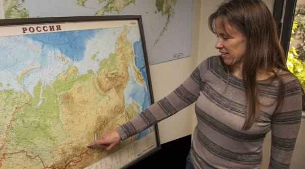 Texas A&M Prof Kelly Graf Points to Map of Russia where skeleton was found. Photo: Texas A&M