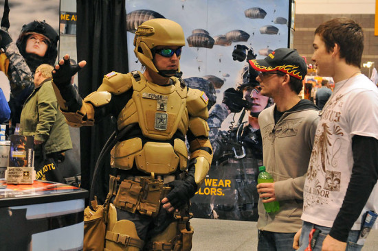 U.S. Army Sgt. 1st Class Matthew Oliver showcases an example of what a soldier may look like in the year 2032 at the 2012 Chicago Auto Show. (Image Source provided by Army PAO)