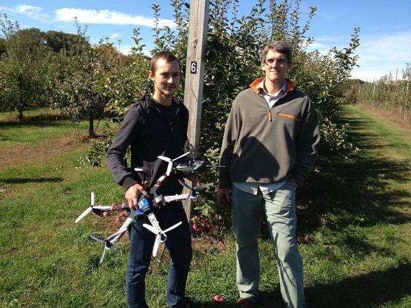 University of New Hampshire doctoral student Matt Wallhead (left) and assistant professor of plant pathology Kirk Broders with the unmanned aerial vehicle they're developing to help apple farmers survey for disease and fungus. Credit: Rachel Rohr