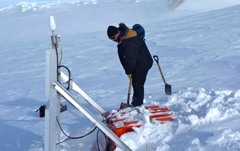 Digging out a seismographic instrument in Antarctica. Credit: Douglas Wiens, Washington University in St. Louis