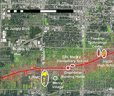 The multiple-vortex storm impacted an area 35 kilometers (22 miles) long and destroyed some 8,000 structures in its path. Click on the image to get full-size version. Aerial image © 2011 GeoEye. Building footprint data Pictometry®. Enhancements by NIST.