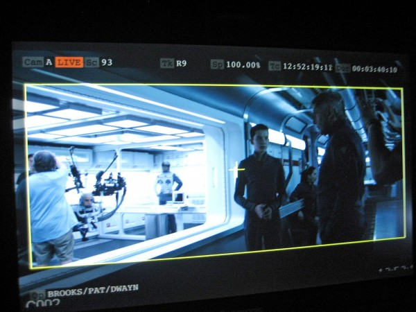 "At right, actors Asa Butterfield and Harrison Ford during the filming of a scene from ""Ender's Game."" The UW robot can be seen on the left. Credit: UW"