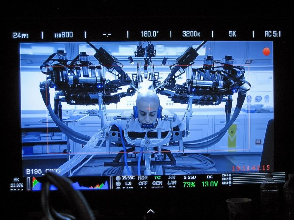 "A close-up shoot of the UW's Raven II robot as it simulates brain surgery on actor Moisés Arias during the filming of ""Ender's Game."" Credit: UW"