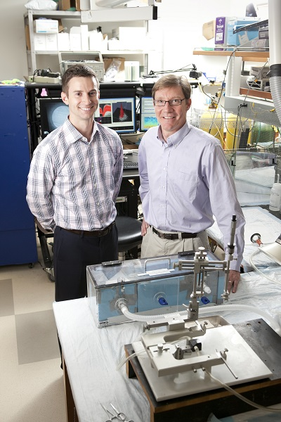 Biomedical engineering PhD student David Brocker (left) and professor Warren Grill with a stereotaxic instrument used to implant electrodes into targeted areas of the brain.