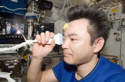 Expedition 33 flight engineer Akihiko Hoshide of the Japan Aerospace Exploration Agency performs ultrasound eye imaging in the Columbus laboratory of the International Space Station. Human research adds to model animal studies to build knowledge of eye health during spaceflight. Credit: NASA