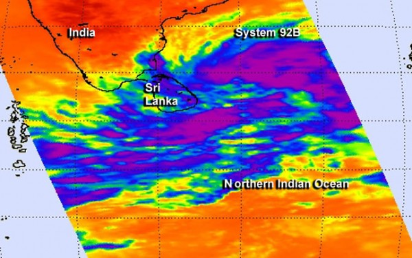 NASA's Aqua satellite passed over System 92B on Dec. 5 at 2:59 a.m. EST. Aqua's AIRS instrument data showed a large area of strong convection and high, cold (purple) thunderstorm cloud tops north and east of the center. Image Credit: NASA JPL, Ed Olsen