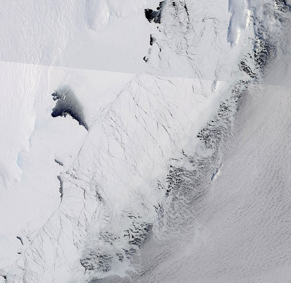 This image shows the Totten Glacier ice shelf in East Antarctica (the wrinkled white area at top left) on Sept. 25, 2013. Image Credit: NASA