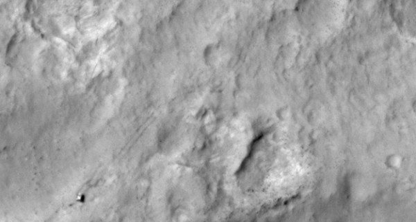 NASA's Curiosity Mars rover and tracks left by its driving appear in this portion of a Dec. 11, 2013, observation by the High Resolution Imaging Science Experiment (HiRISE) camera on NASA's Mars Reconnaissance Orbiter. The rover is near the lower-left corner of this view. Image Credit: NASA/JPL-Caltech/Univ. of Arizona