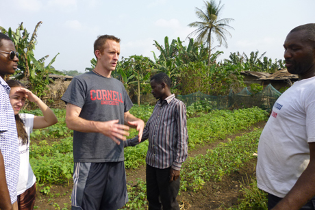 Timothy Smith '14 speaks with Cameroon farmers about their needs for cocoa seedling development. Credit: Timothy Smith