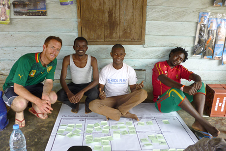 Smith works with Bekondo Foundation founders on its mission and vision using the social business generation model. Credit: Timothy Smith