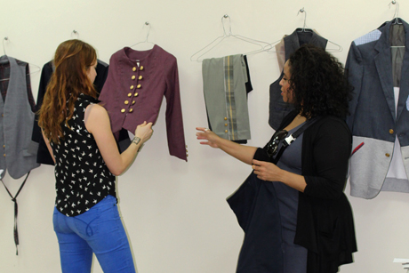 FSAD assistant professor Tasha Lewis, right, inspects garments with company co-founder Anne Pringle at the LB Designs Factory in Haiti.