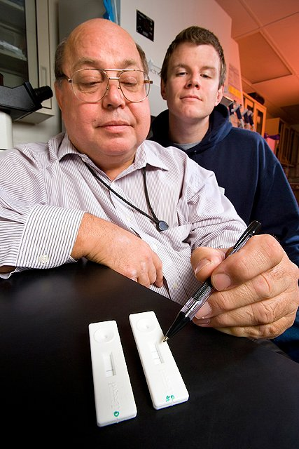 Biologist Larry Stanker (foreground) and biochemist Miles Scotcher evaluate the results of an assay, developed with a corporate partner, designed to detect botulism toxin in as little as 15 minutes from a single drop of sample. Photo by Stephen Ausmus.