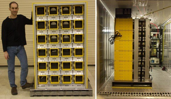 Pallet-mounted HPGe array with the front view of array (left), and a side view of array installed in ISO container (right). Team member, Dr Eric Wulf, stands by the array for size comparison.  (Photo: U.S. Naval Research Laboratory)