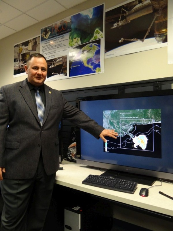 """Dr. Jason Jolliff recently published a paper showing NRL's capability to forecast a material in ocean currents applies to the 2010 Deepwater Horizon oil spill. """"The tools we developed here at NRL are state of the art, without question,"""" he says. (Photo: U.S. Naval Research Laboratory/Shannon Mensi)"""