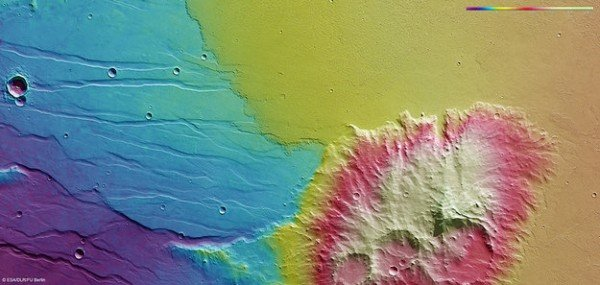 Colour-coded topography map of Daedalia Planum, featuring a segment of highland terrain that is home to Mistretta Crater, the largest of the three eroded impact craters. White and red show the highest terrains, while blue and purple show the deepest. The image is based on a digital terrain model of the region, from which the topography of the landscape can be derived. The region clearly slopes to the south (left). This region was imaged by the high-resolution stereo camera on ESA's Mars Express on 28 November 2013 (orbit 12 593), with a ground resolution of 14 m per pixel. The image centre is at about 25ºS/249ºE. North is right and east down. Copyright ESA/DLR/FU Berlin