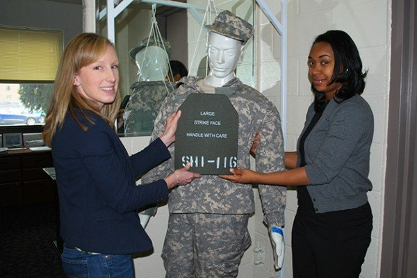 Researchers from the U.S. Army Research Laboratory continue to expand body armor analysis work to protect Soldiers - not only protecting their lives, but also their daily life functions after treatment and recovery. Shown here is Rebecca VanAmburg (left), who is assisted by Latrice Hall (right), determining the proper placement of hard armor on a Soldier mannequin.